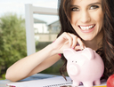 Young woman saving money piggy bank