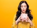 Young woman with a piggy bank