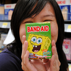 Woman holding Spongebob Band-Aids