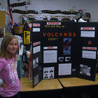 Child with science fair presentation