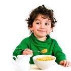 Kid eating corn flakes