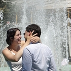 Couple in front of a fountain