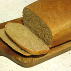 Just-sliced loaf of fresh-baked bread