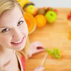 woman chopping fruits