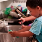 Kids washing dishes