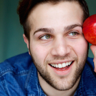man holding apple