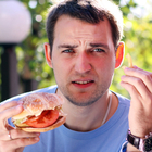 man eating fast food