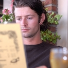 man reading menu