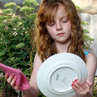 Girl washing plate