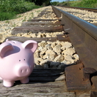 Piggy bank waits for the train