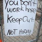Sign that reads:  You don't work here.  Keep out.  Not hiring.