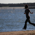 woman runnning near water