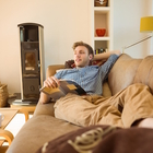 young man reading couch
