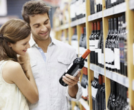 Couple at the store buying wine in bulk
