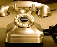 gold retro telephone