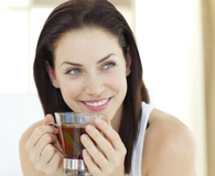 Woman drinking health tea to boost metabolism