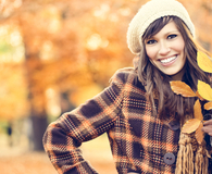 Woman using leaves to frugally decorate for fall