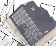 Aerial view of house with solar panels