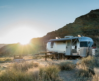 Airstream Trailer in Mojave Desert at Sunset