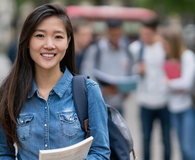 Asian student on the street looking at the camera smiling