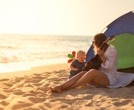 Mother and baby in best beach tent