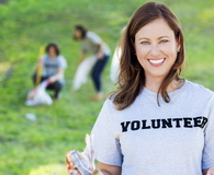 Beautiful Caucasian female volunteers in local park