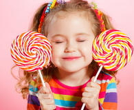 Beautiful little girl with lollipop