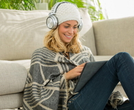 Beautiful woman listening music at home