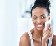 Woman using at home skincare essentials