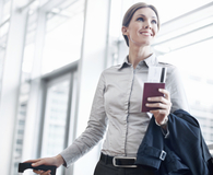 Woman with business travel that's helping her wallet