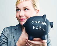 Businesswoman with piggybank