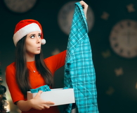 Christmas Woman Receiving Pajamas as Gift