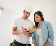 Contractor talking to a woman at home