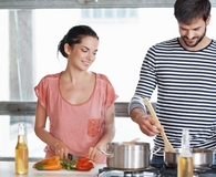 Couple making no-fuss dinner that save them money