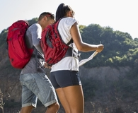Couple wearing the best backpacks while hiking