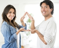 Couple learning what they need to buy a house