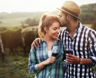 Couple in love working at winemaker vineyard