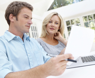 Couple learning which money mistakes to avoid by 50