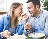 Couple eating at their favorite restaurant