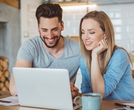 Couple learning they've improved their credit scores