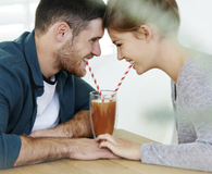 Couple enjoying delicious things made in a blender