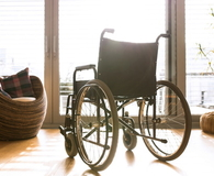 Empty wheelchair in living room