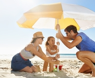 Family using best beach umbrella