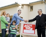 Family using real estate agent to sell their home