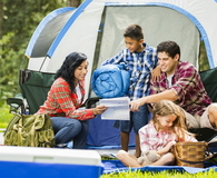 Family camping outdoors in forest