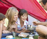 Family using helpful tips for camping cooking
