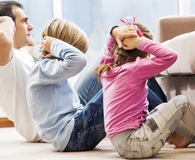 Family exercising together during 2-minute commercial break