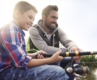 Father and son beating stress with inexpensive pastimes