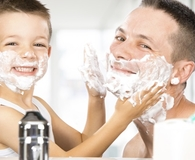 Father and son using best shaving creams on their faces