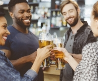 Friends learning if happy hour can help them manage debt